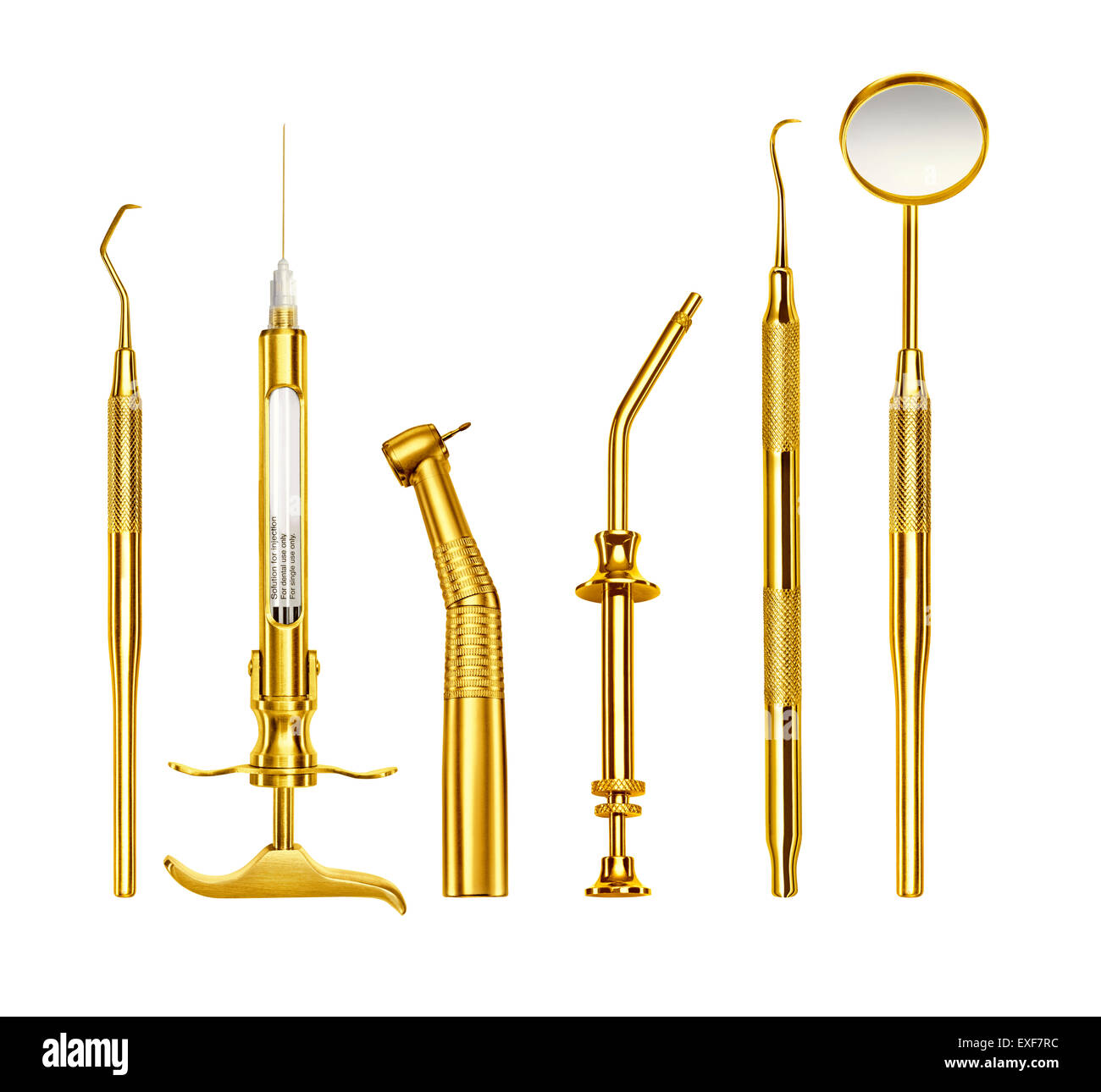 A row of gold dentist tools - Stock Image