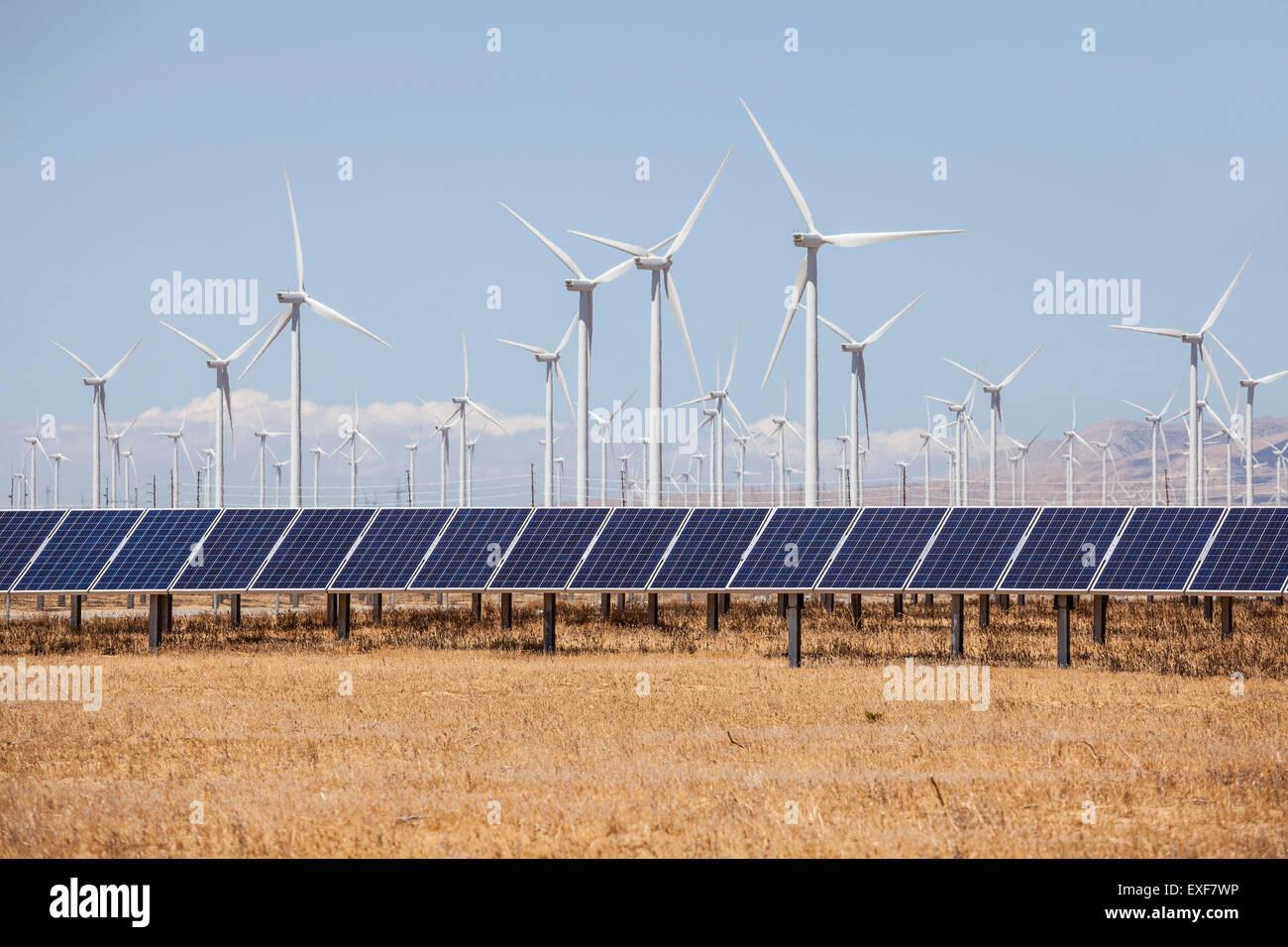 Wind mills and solar panels alternative energy production. - Stock Image