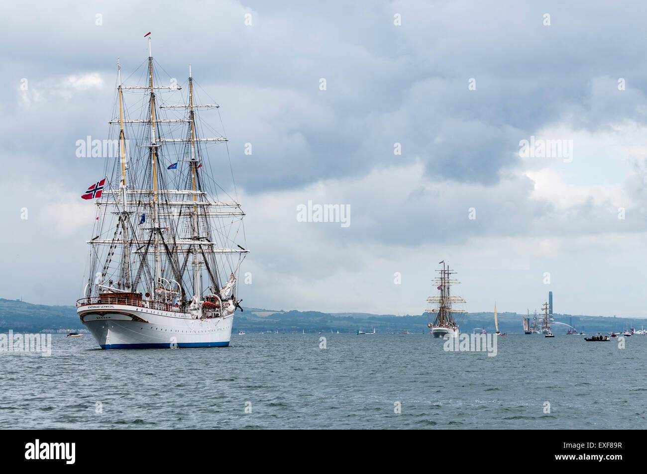 Class A Tall Ship, Statsraad Lehmkuhl leaves Belfast during the start of the 2015 Tall Ships race - Stock Image