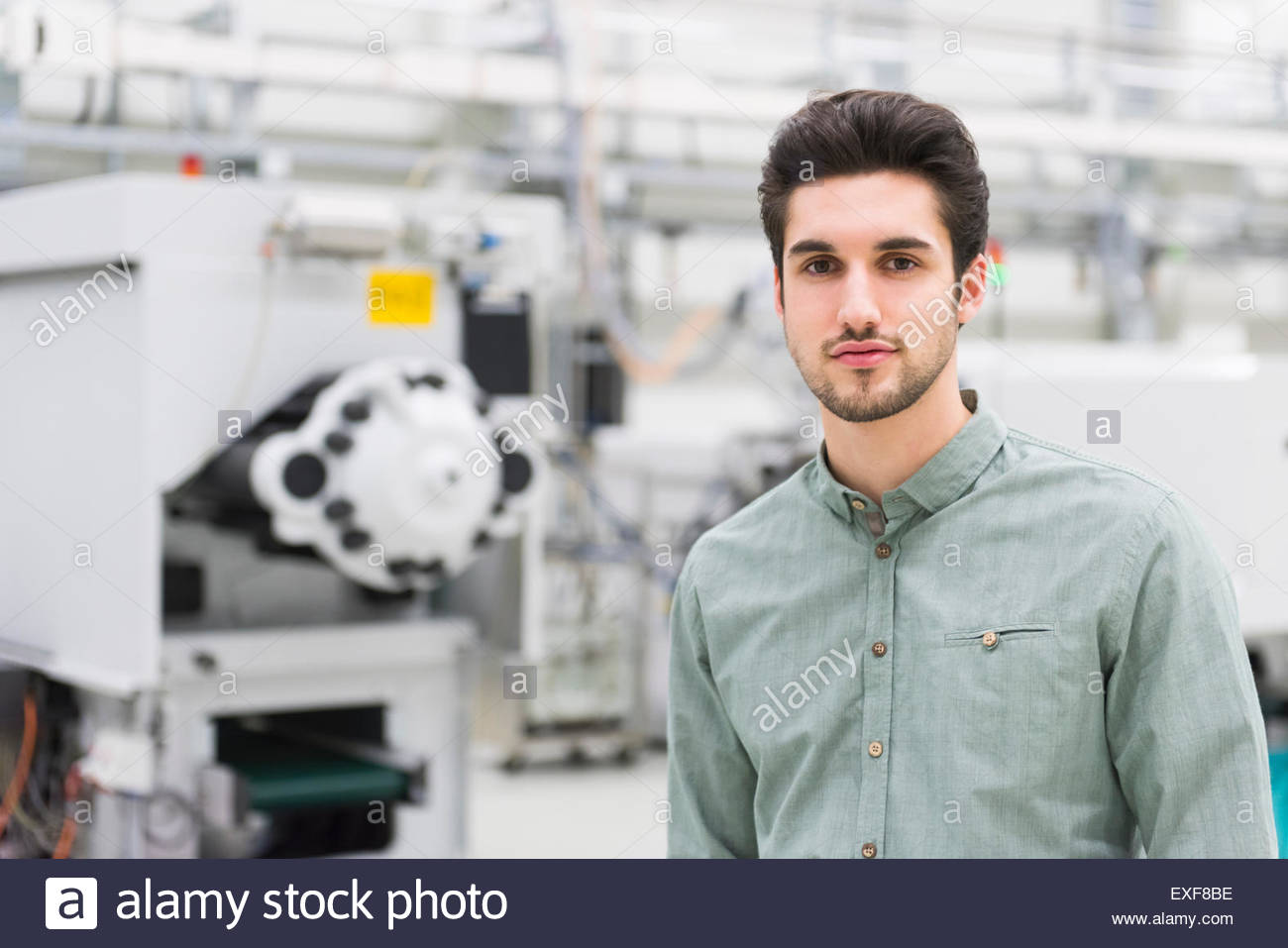 Portrait of male worker at tool manufacturing plant - Stock Image