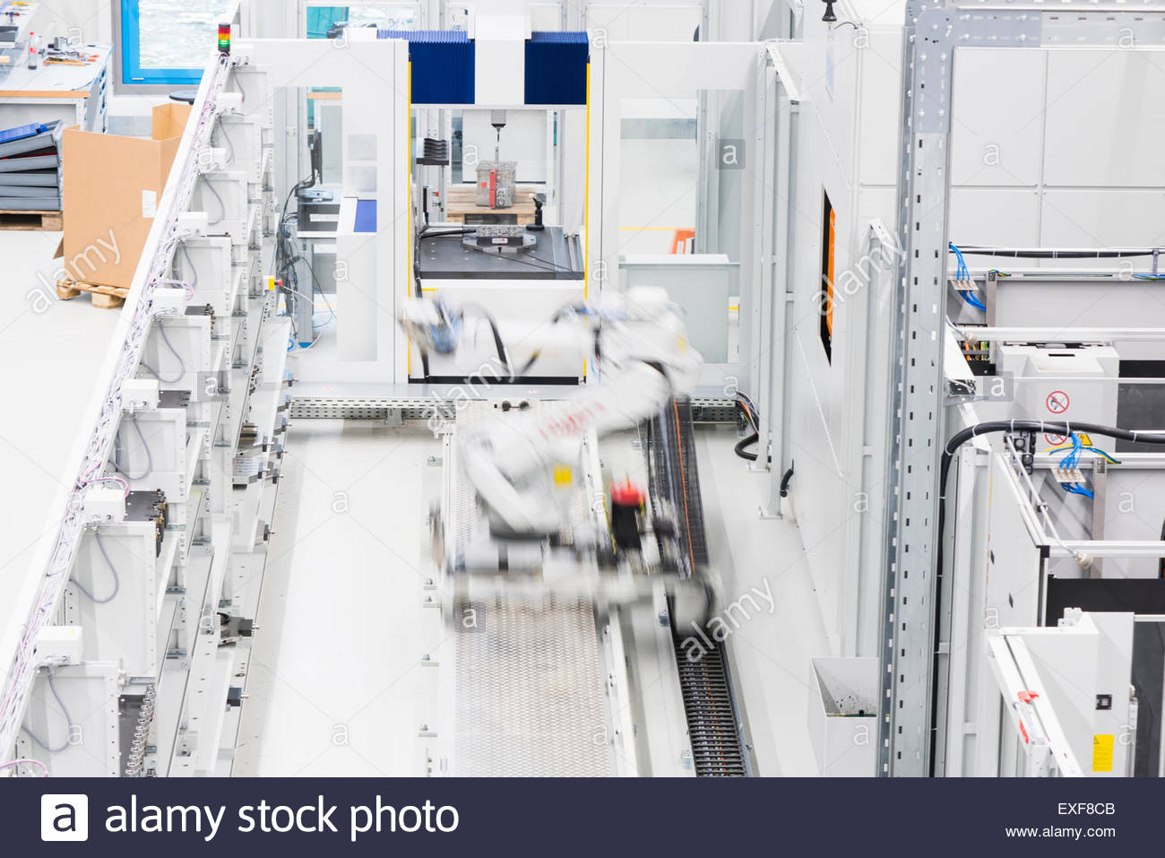 Industrial production line with moving automated robot - Stock Image