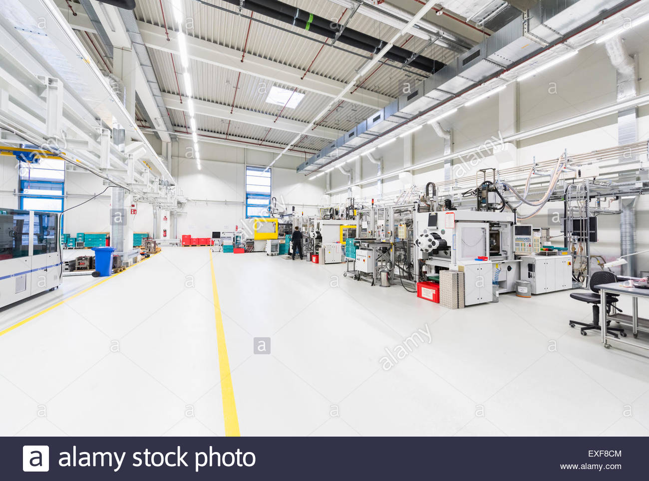 Rows of work stations in factory - Stock Image