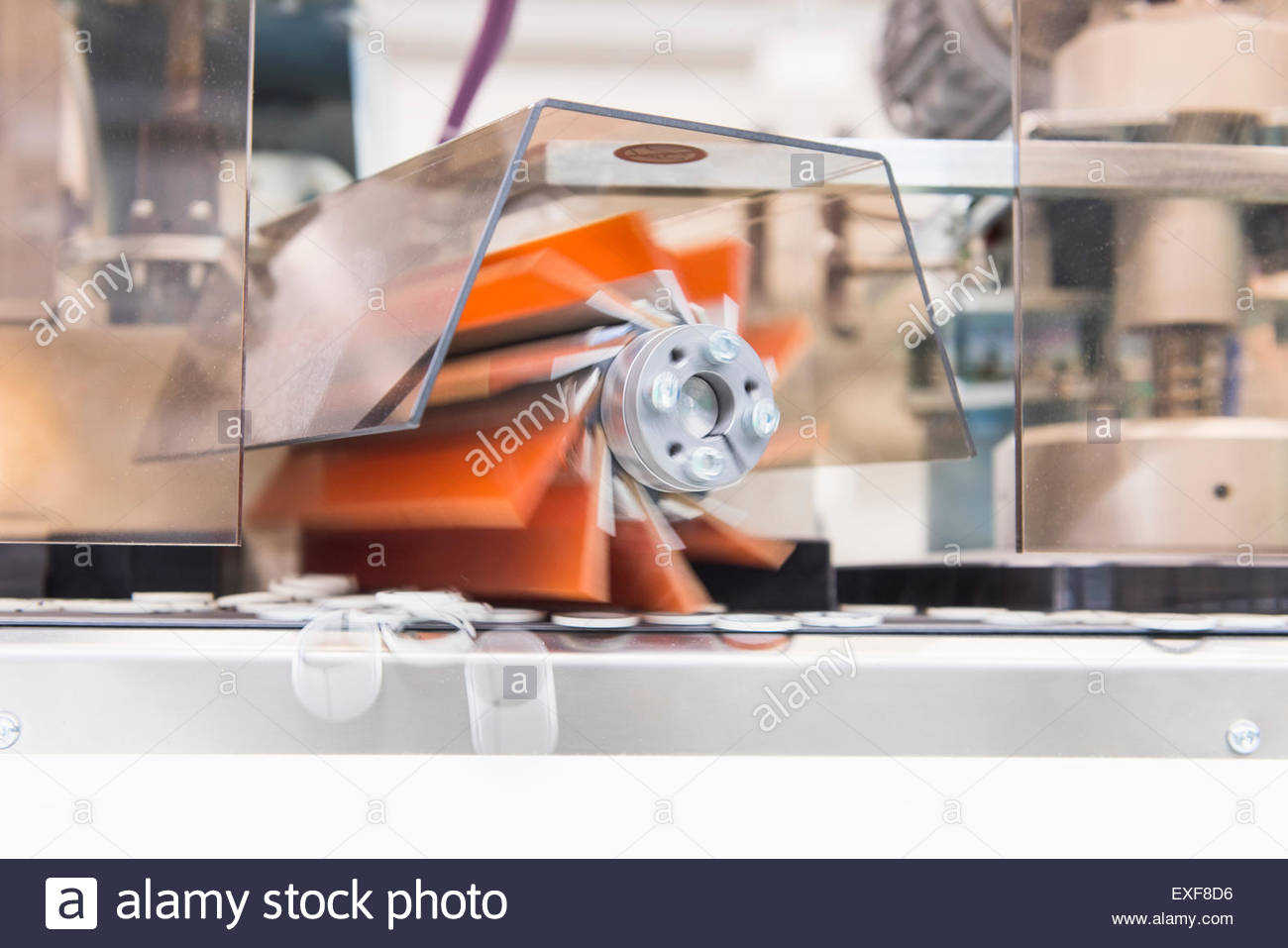 Close up of rotating equipment sorting products in factory - Stock Image