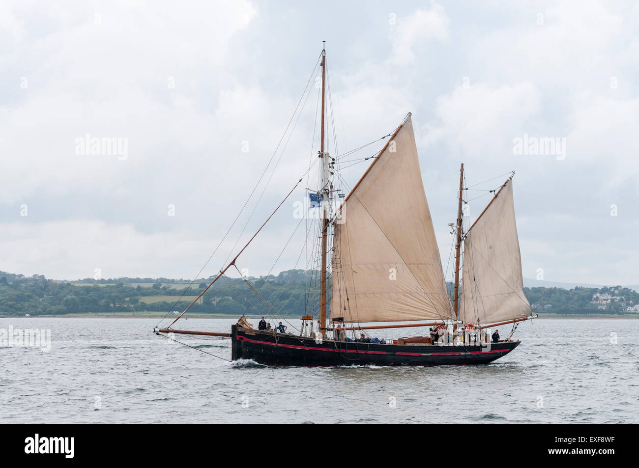 British gaff Ketch sailing ship Leader leaves Belfast for the start of the 2015 Tall Ships race - Stock Image