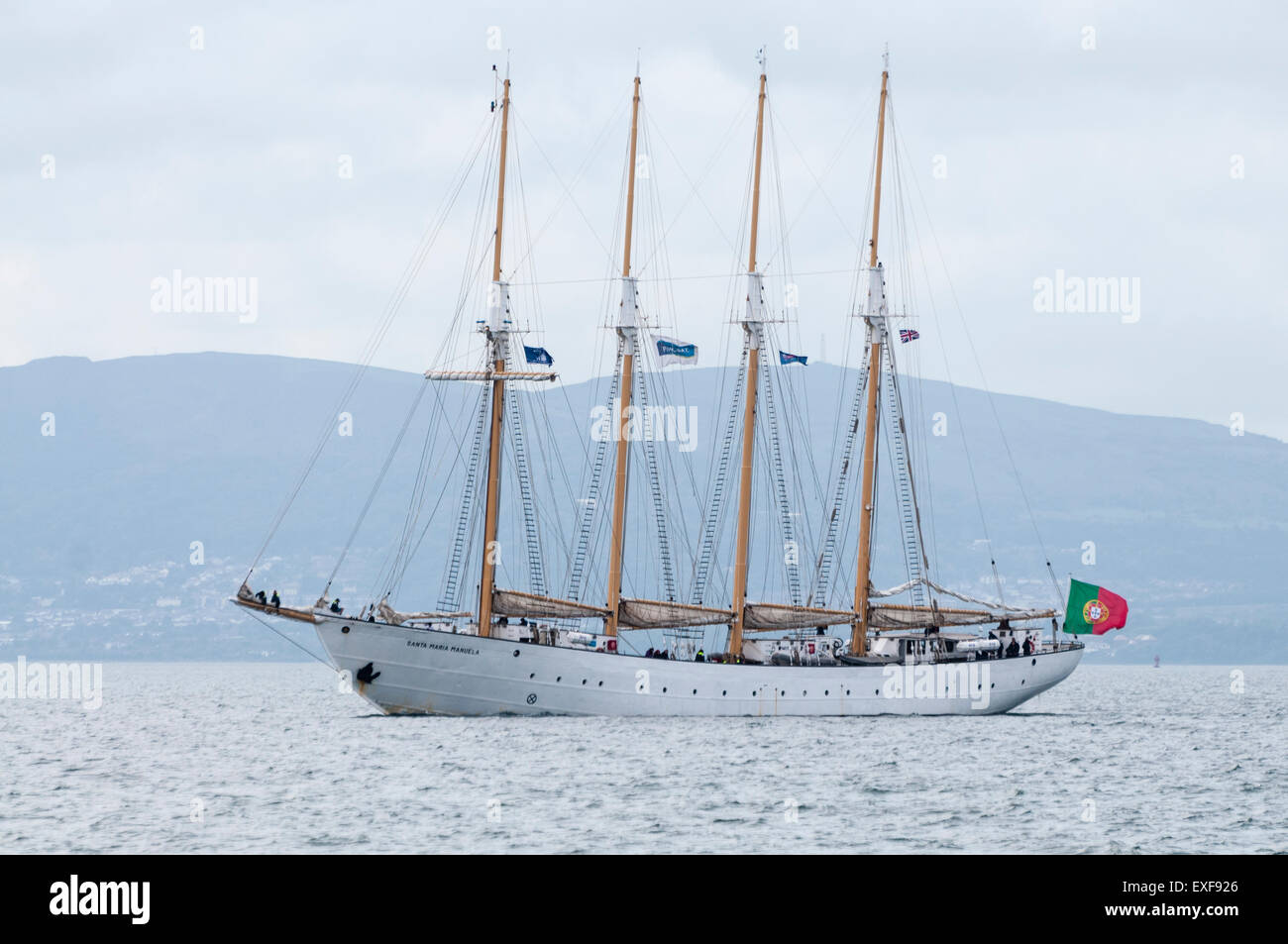 The four masted schooner Santa Maria Manuela sails out of Belfast - Stock Image