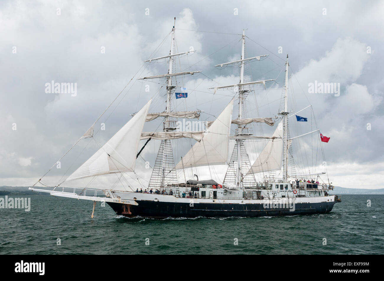 The Lord Nelson ship leaves Belfast during the start of the 2015 Tall Ships race - Stock Image