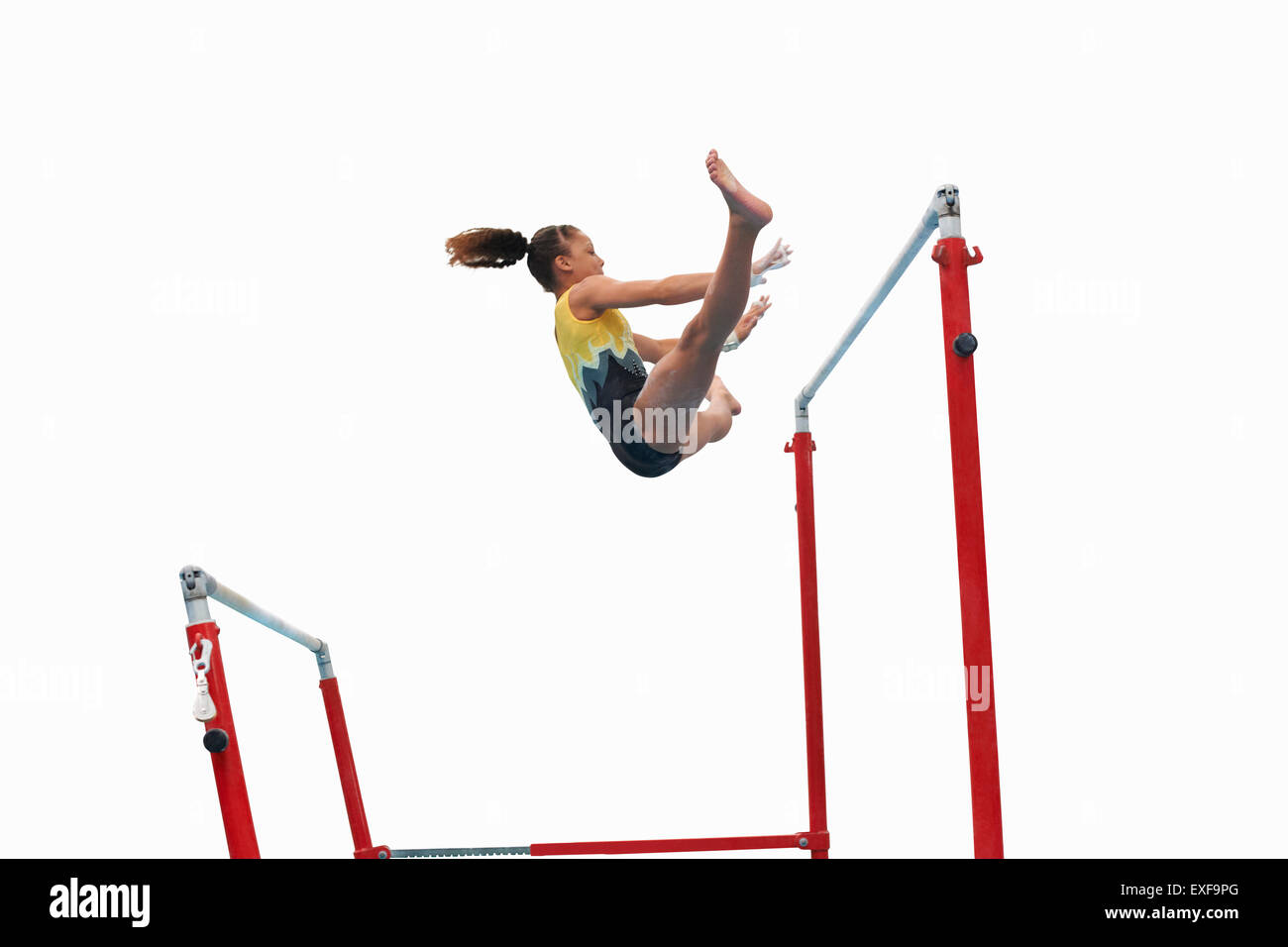 Young gymnast performing on uneven bars - Stock Image
