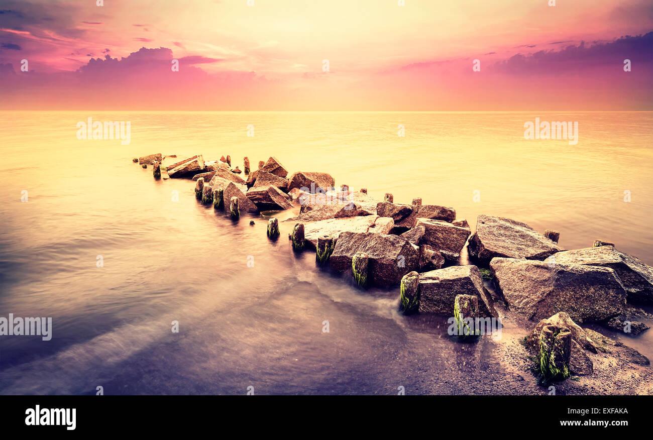 Vintage toned beautiful sea landscape after sunset. - Stock Image