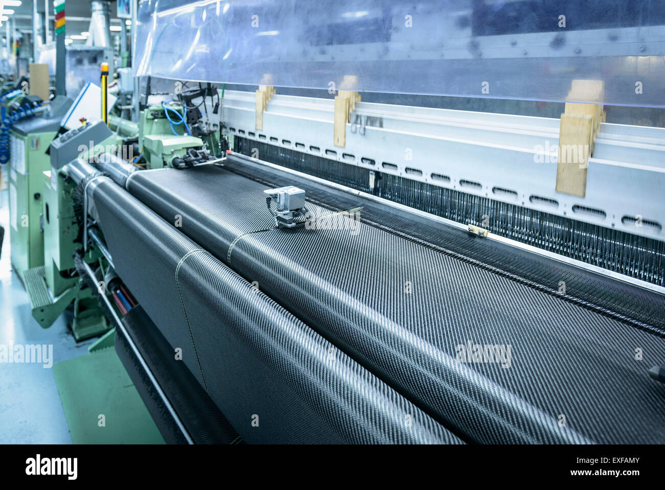 Carbon fibre loom in detail in carbon fibre factory - Stock Image