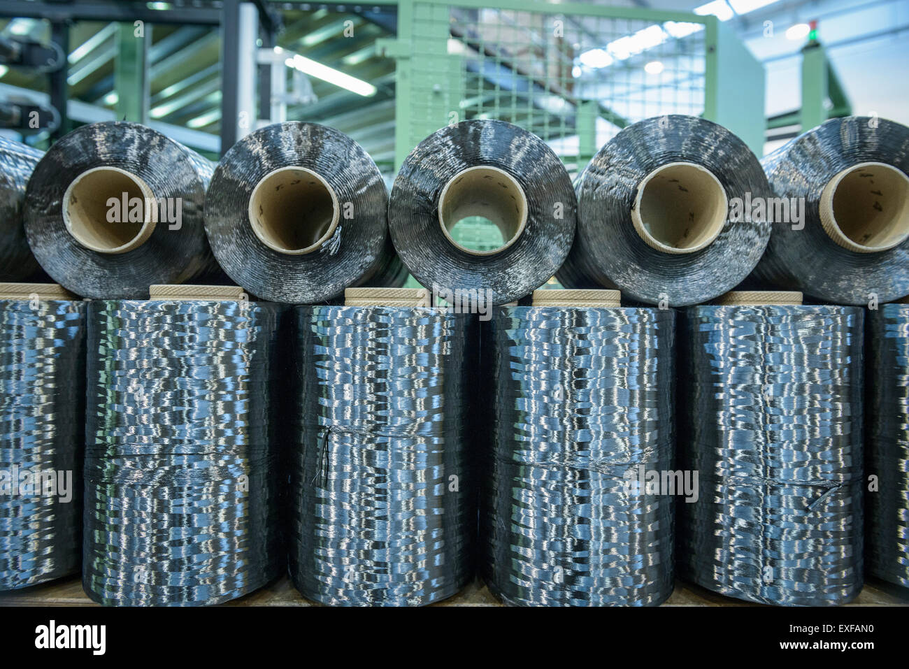 Rows of carbon fibre in carbon fibre factory - Stock Image