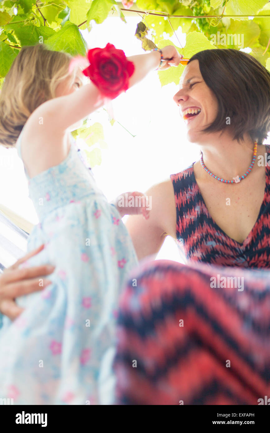 Daughter combing mother's hair - Stock Image