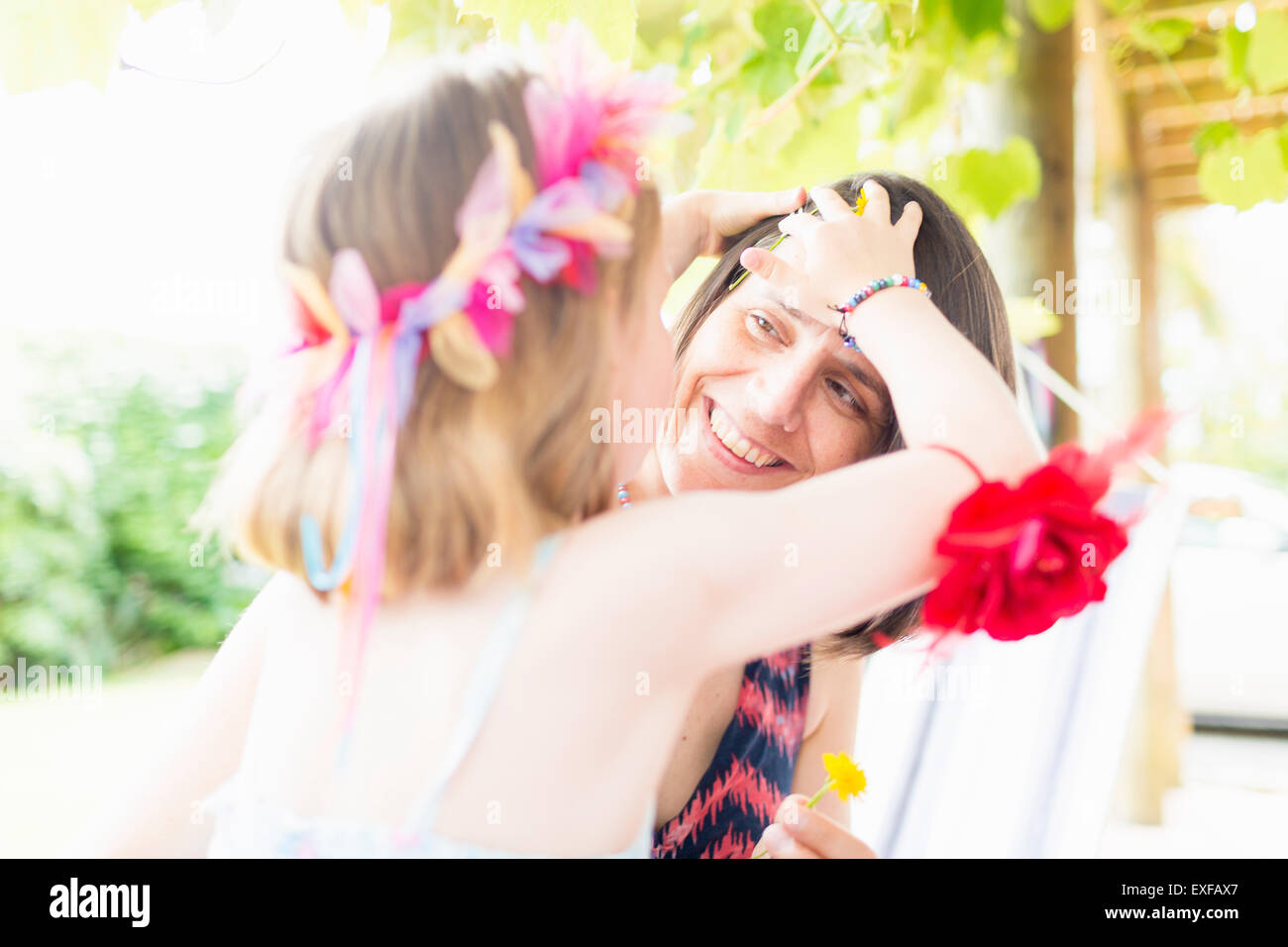 Daughter styling mother's hair - Stock Image