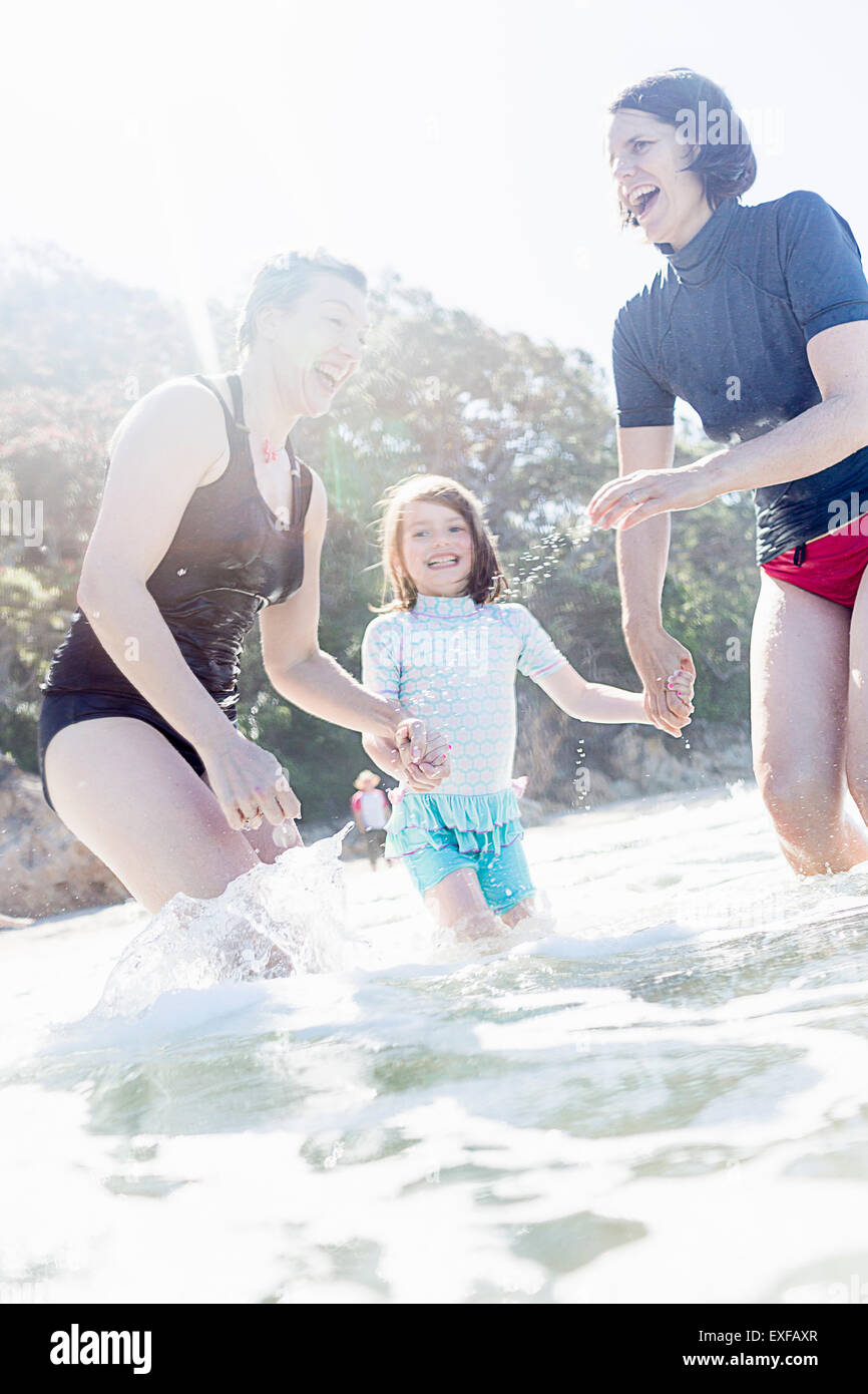 Mother and daughter, with friend, by the seaside - Stock Image