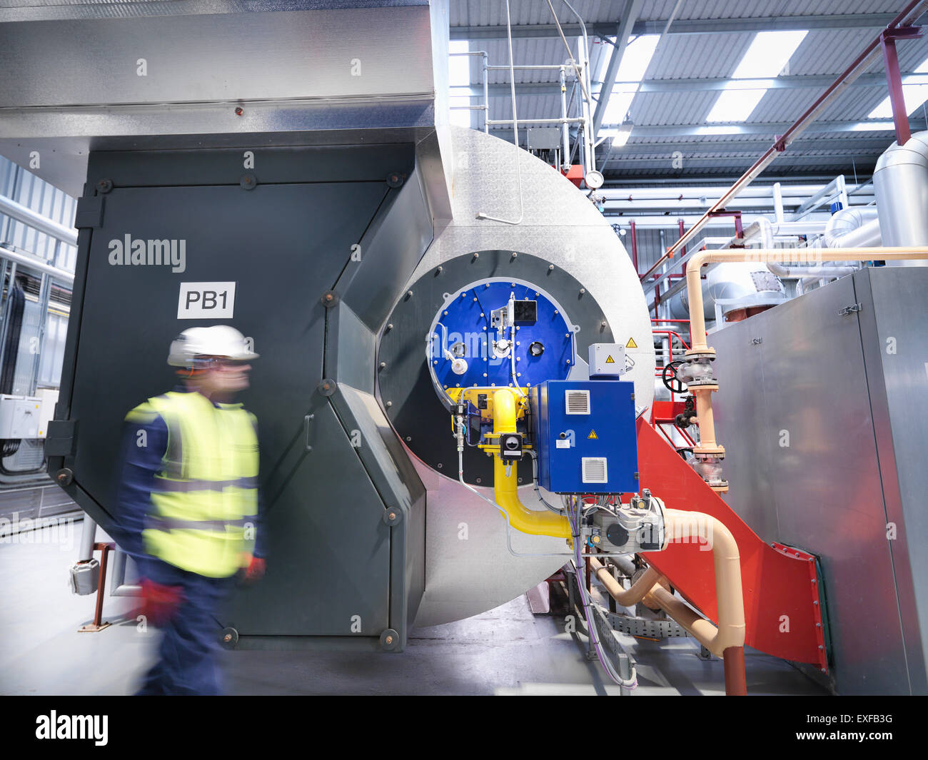 Worker in gas fired power station - Stock Image