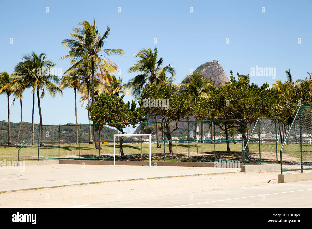 Empty basketball and soccer court in front of Sugarloaf mountain, Rio De Janeiro, Brazil - Stock Image