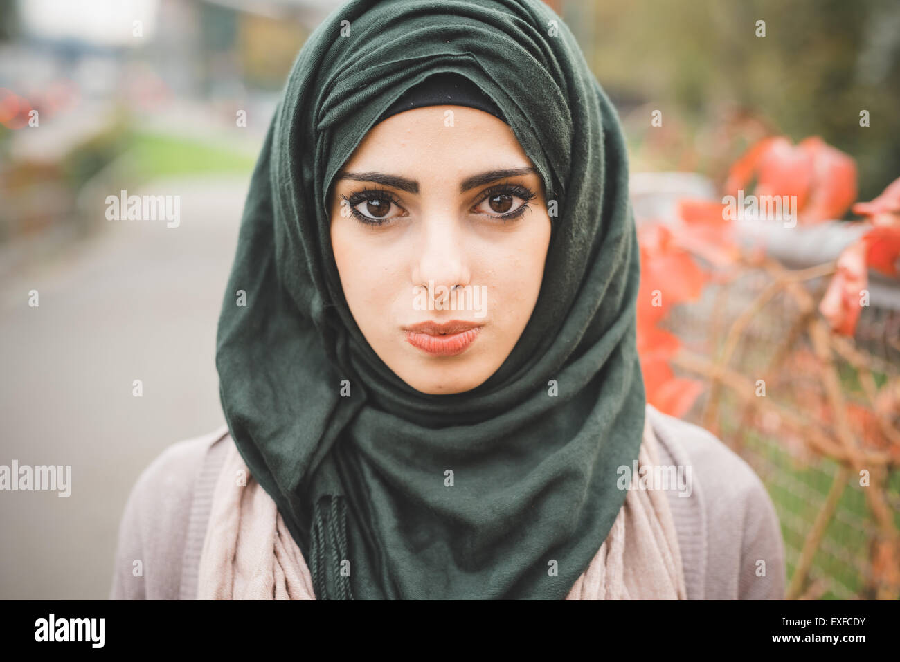 Close up portrait of young woman wearing hijab - Stock Image