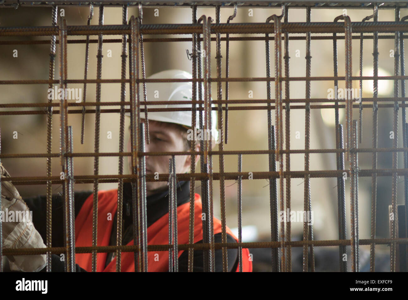 Factory worker selecting wire mesh in concrete reinforcement factory Stock Photo