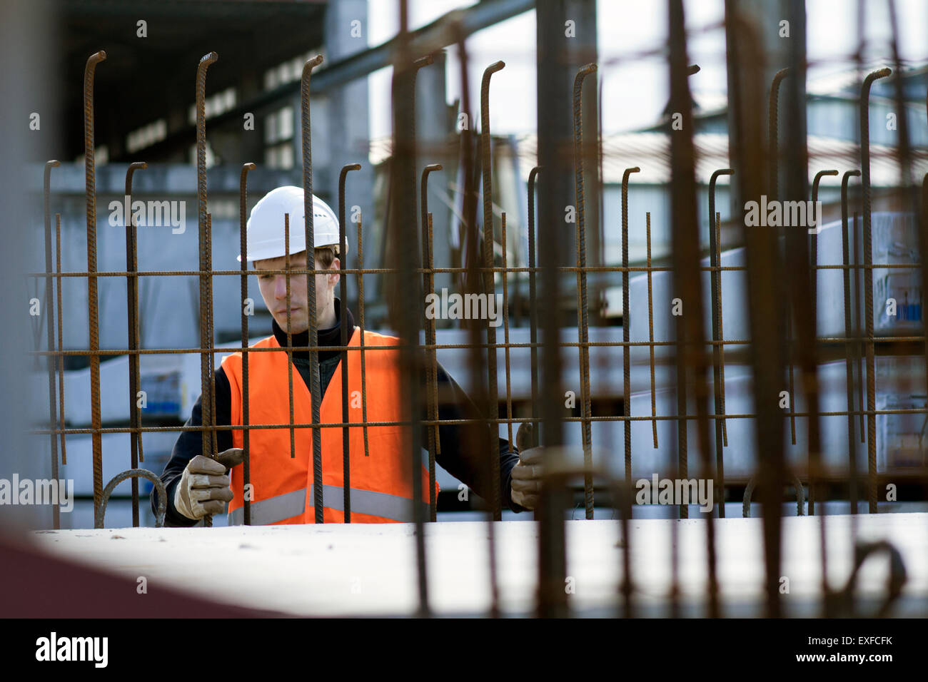 Factory worker choosing wire mesh in concrete reinforcement factory Stock Photo