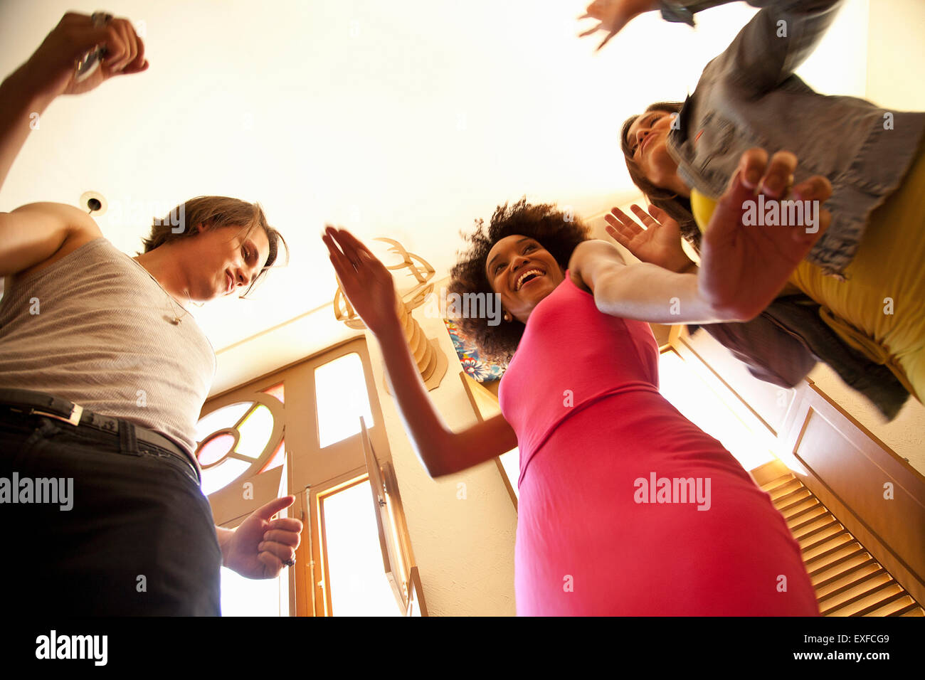 Students dancing, view from below - Stock Image