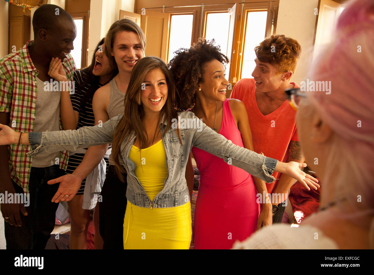Students welcoming and greeting lecturer - Stock Image