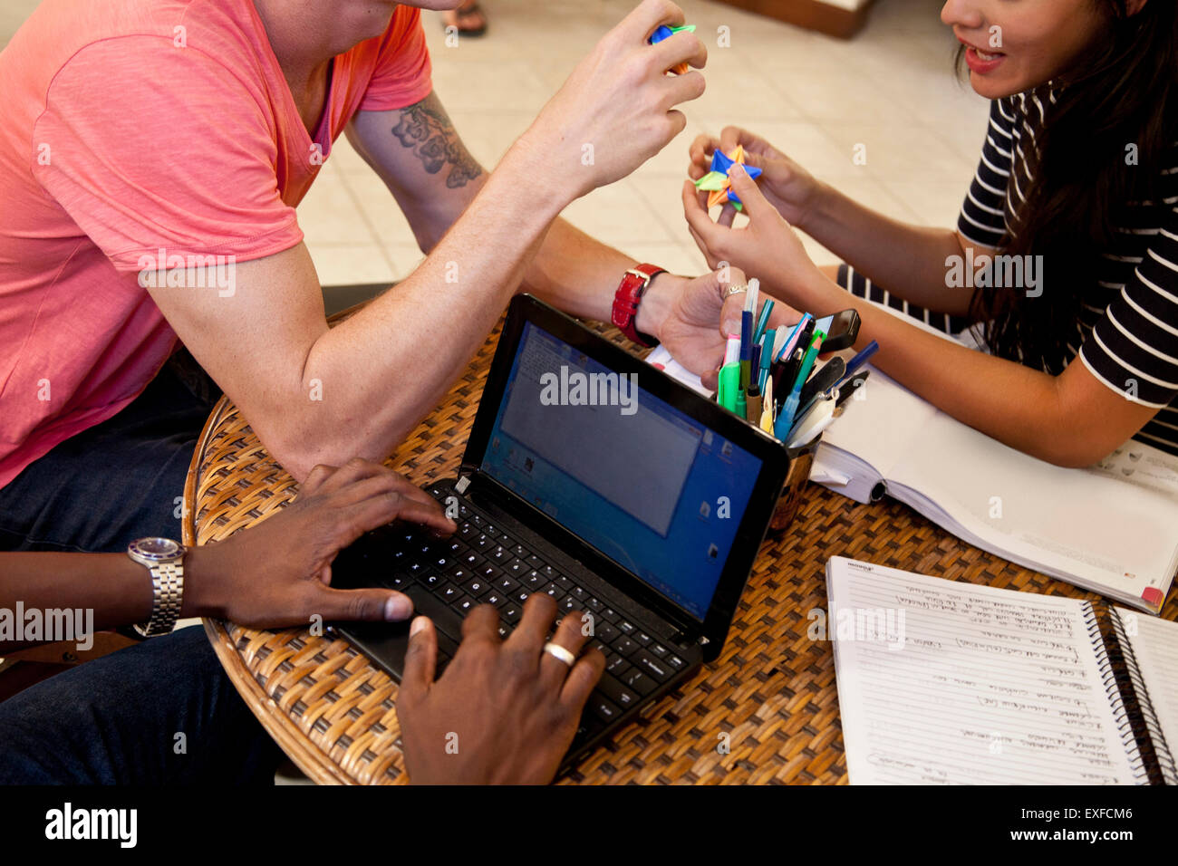 Students using laptop and relaxing - Stock Image