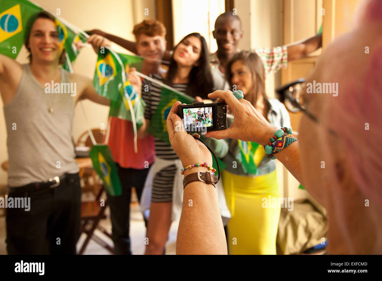 Students celebrating with Brazilian flags - Stock Image