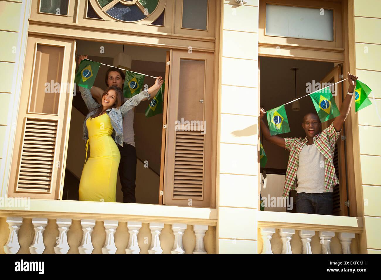 Students celebrating with Brazilian flags, Rio de Janeiro, Brazil - Stock Image