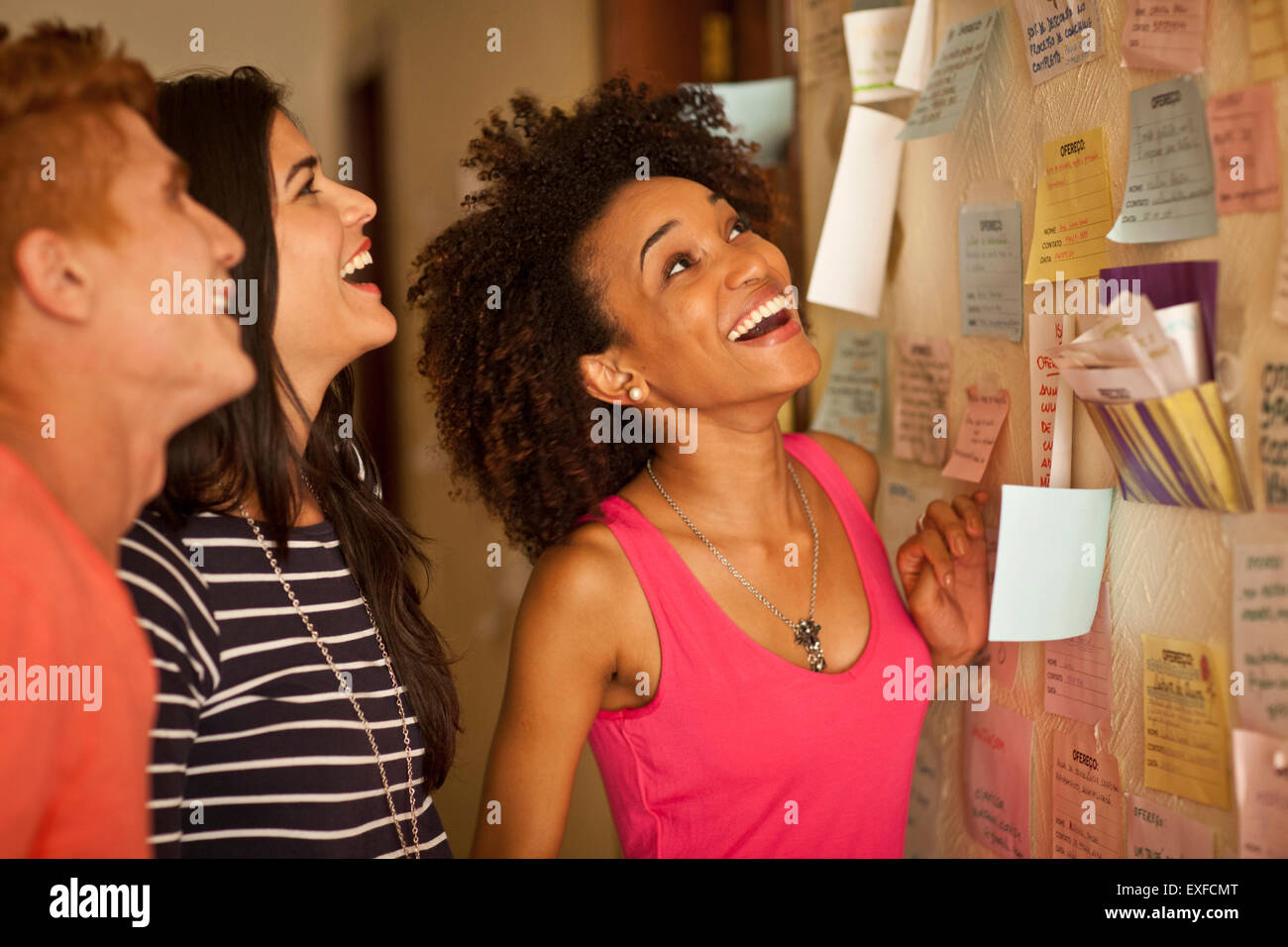 Students looking at notice board - Stock Image