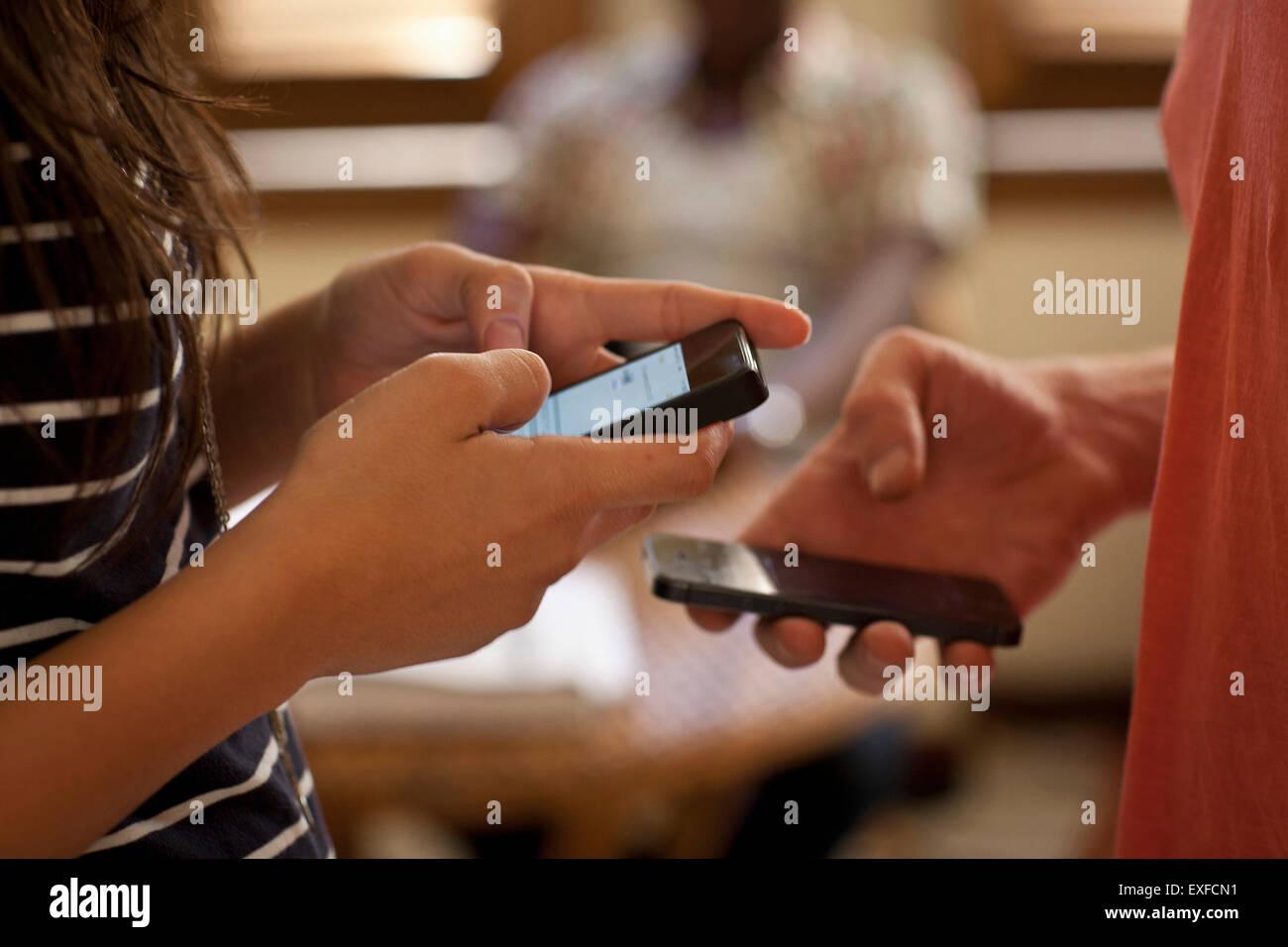 Student using smartphones - Stock Image