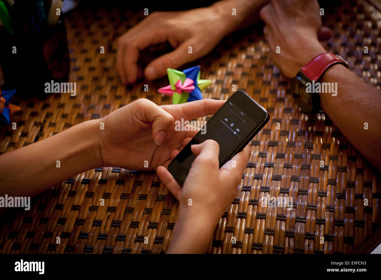 Students texting and relaxing, partial view of hands - Stock Image