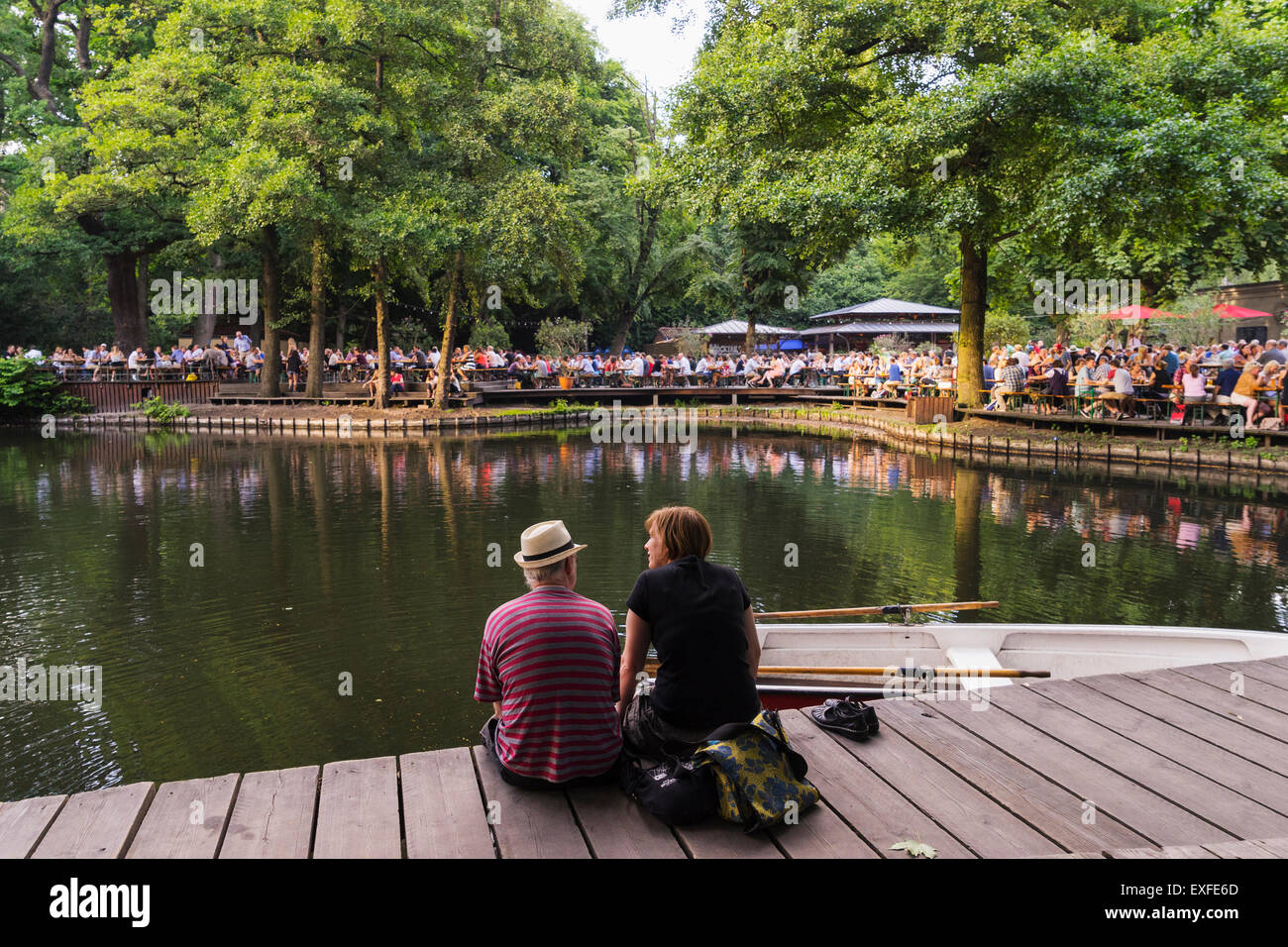Busy beer garden in summer at Cafe am Neuen See in Tiergarten park in Berlin Germany - Stock Image