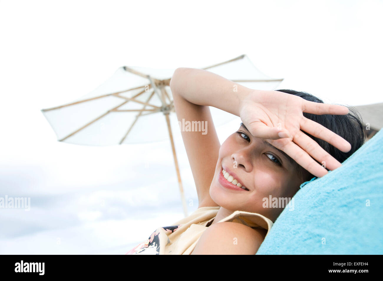 Portrait of woman relaxing on beach, Ari Atoll, Maldives Stock Photo