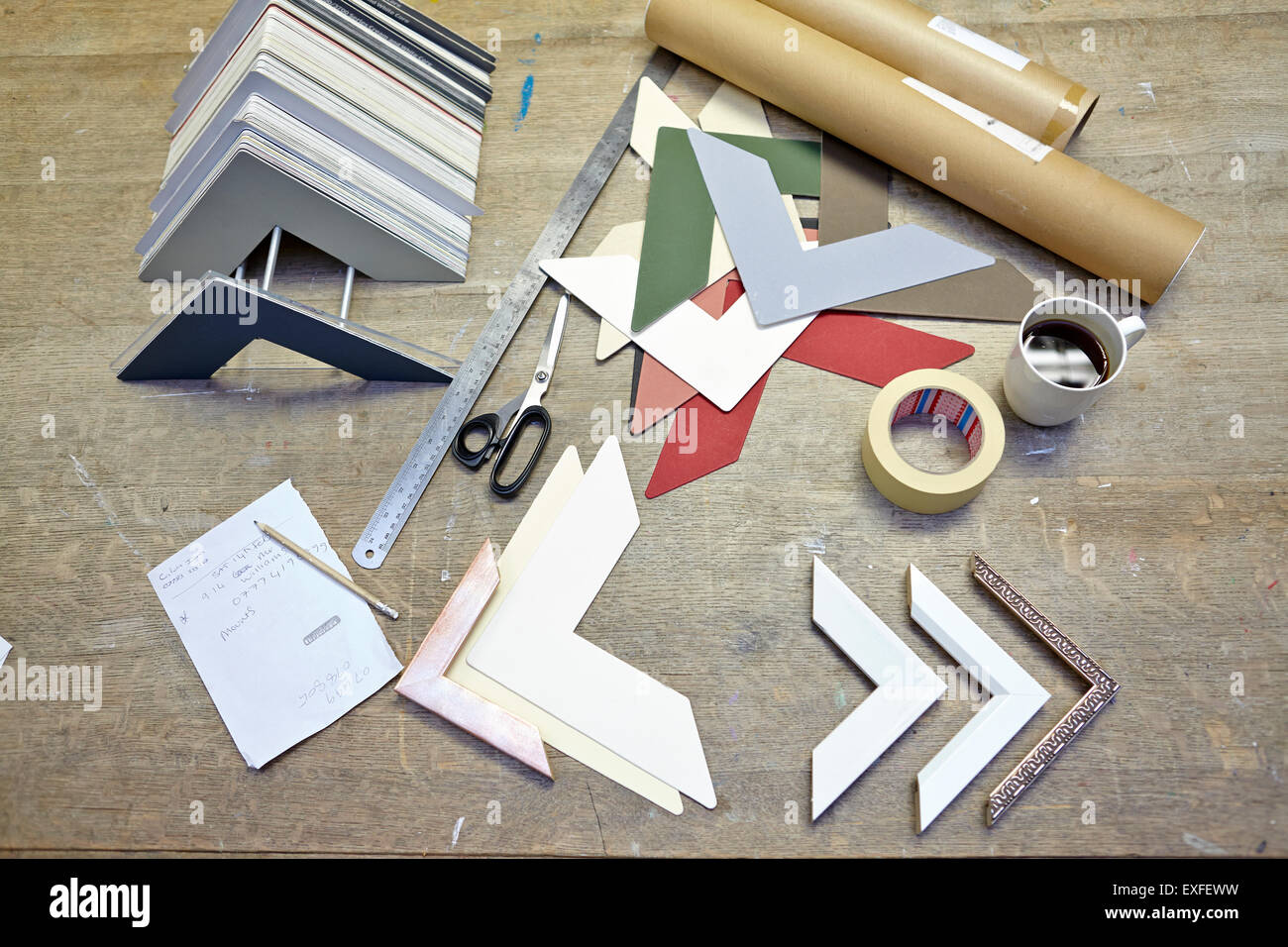 Still life of framing equipment in picture framers workshop - Stock Image