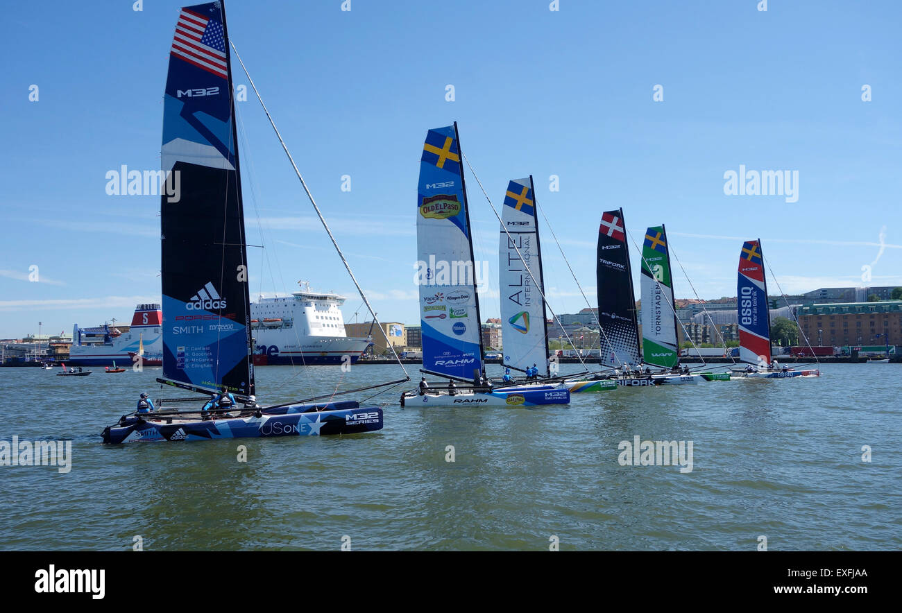 Catamaran m32 series on start line for sailing race in Gothenburg 2015-06-12. Sweden - Stock Image