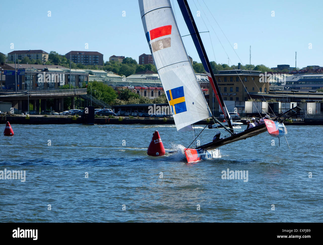 Catamaran m32 Series Hull flying while turn around buoy mark on the sailing race course in  Gothenburg 2015-06-12. - Stock Image
