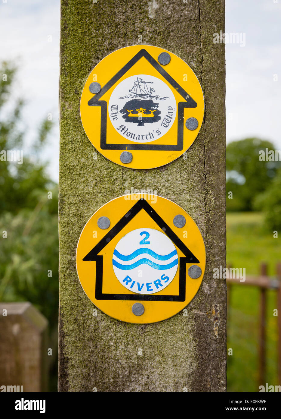 National trail markers as the Monarch's and Two Rivers Way share the same path in Somerset UK - Stock Image