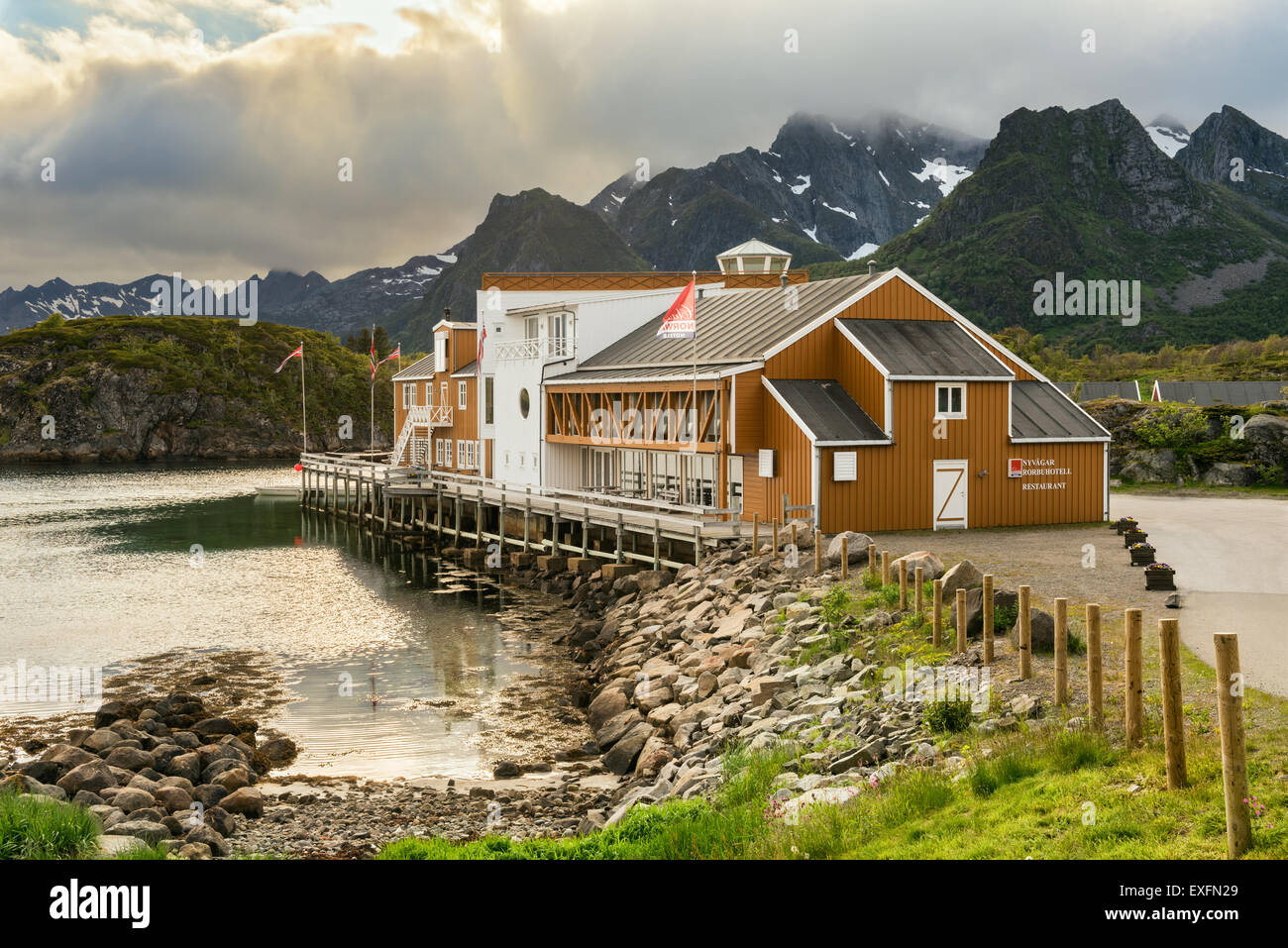 Nyvagar Rorbuhotell in Kabelvag idyllically located at the Lofoten Sea with dramatic clouds at sunset - Stock Image