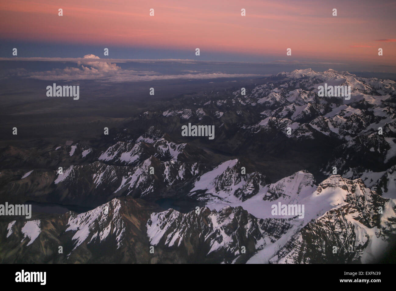 snow-capped view over the Andes mountains taken from the plane - Stock Image