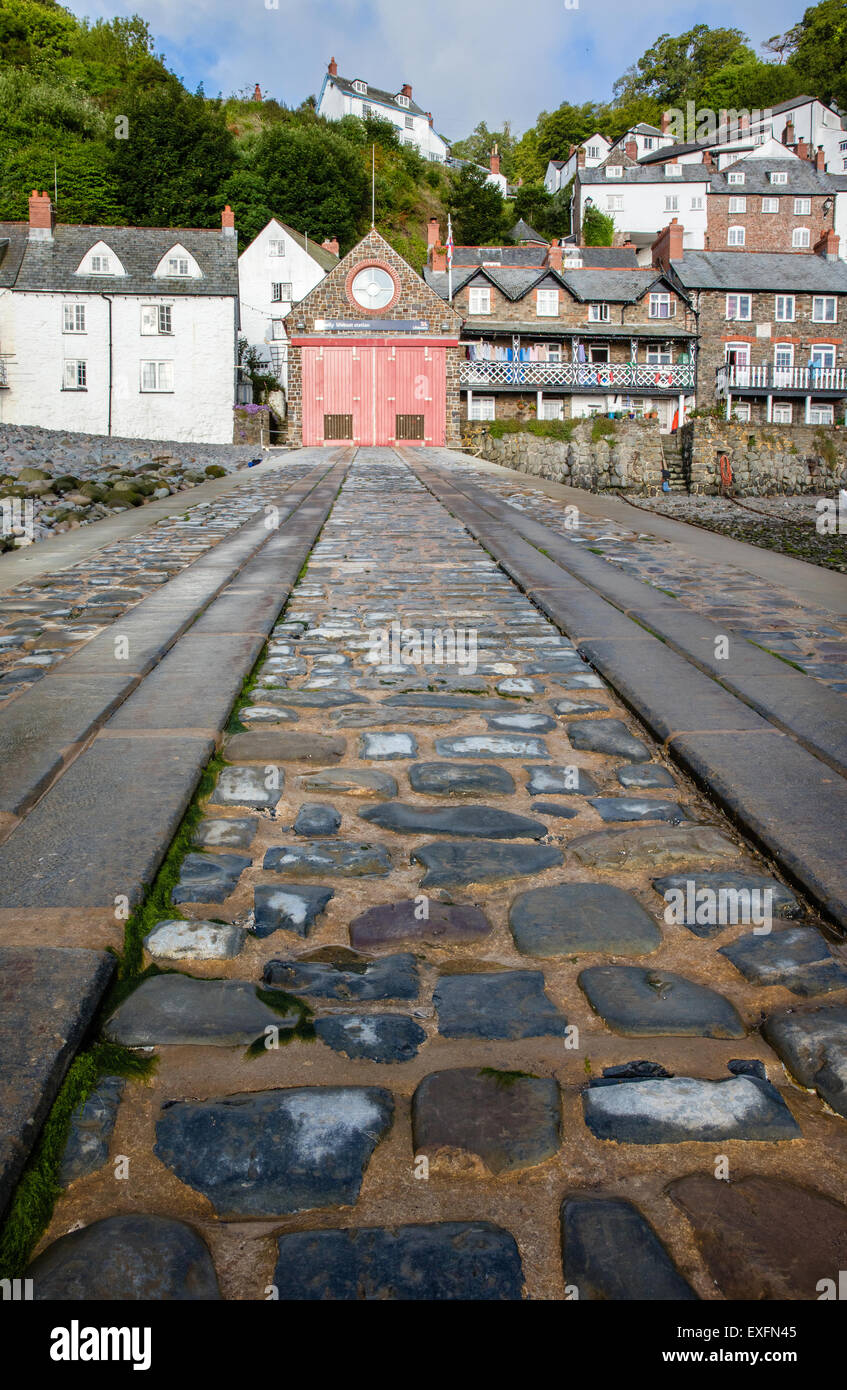 Steep slipway of the Clovelly lifeboat in the Devon seaside village harbour UK - Stock Image