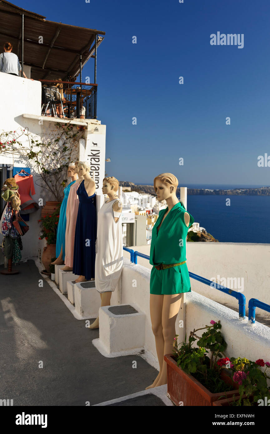 Female mannequins wearing summer clothes on show outdoors a shop in Fira, Santorini, Greece. - Stock Image