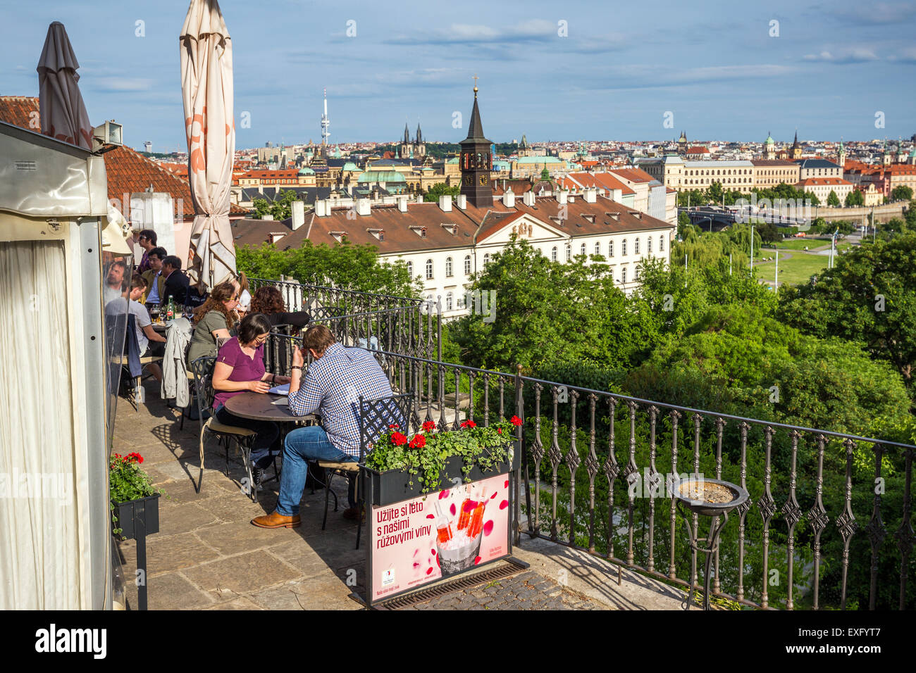 Tourists on the outdoor terrace of a restaurant below the castle,  Prague, Czech Republic, Europe - Stock Image