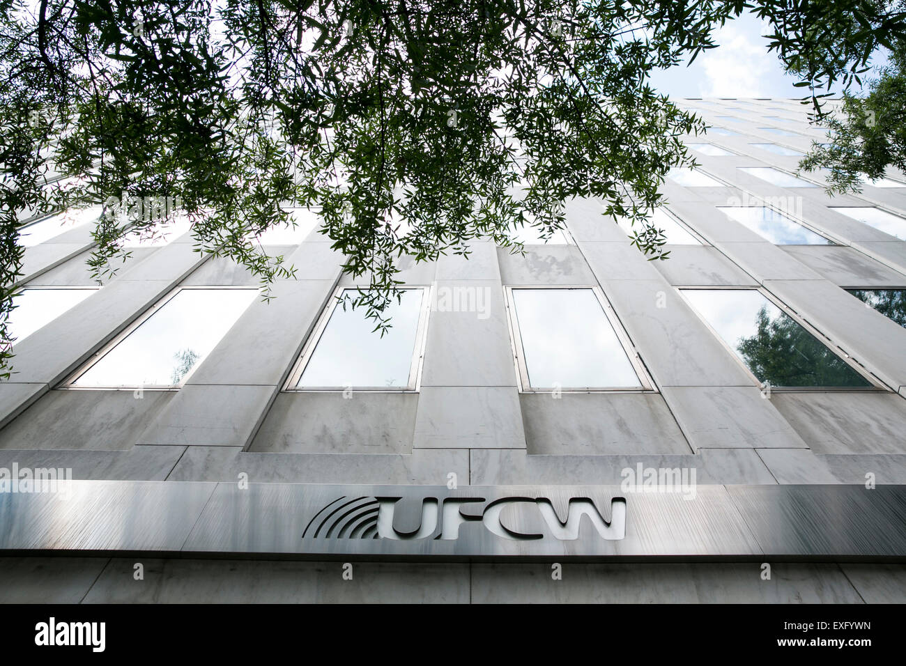 A logo sign outside of the headquarters of the United Food and Commercial Workers International Union (UFCW) in - Stock Image