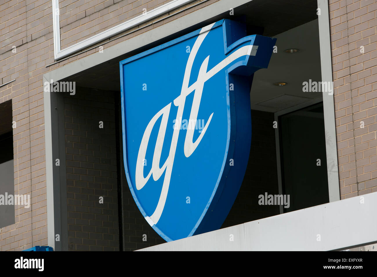 A logo sign outside of the headquarters of the American Federation of Teachers (AFT) in Washington, D.C. on July - Stock Image