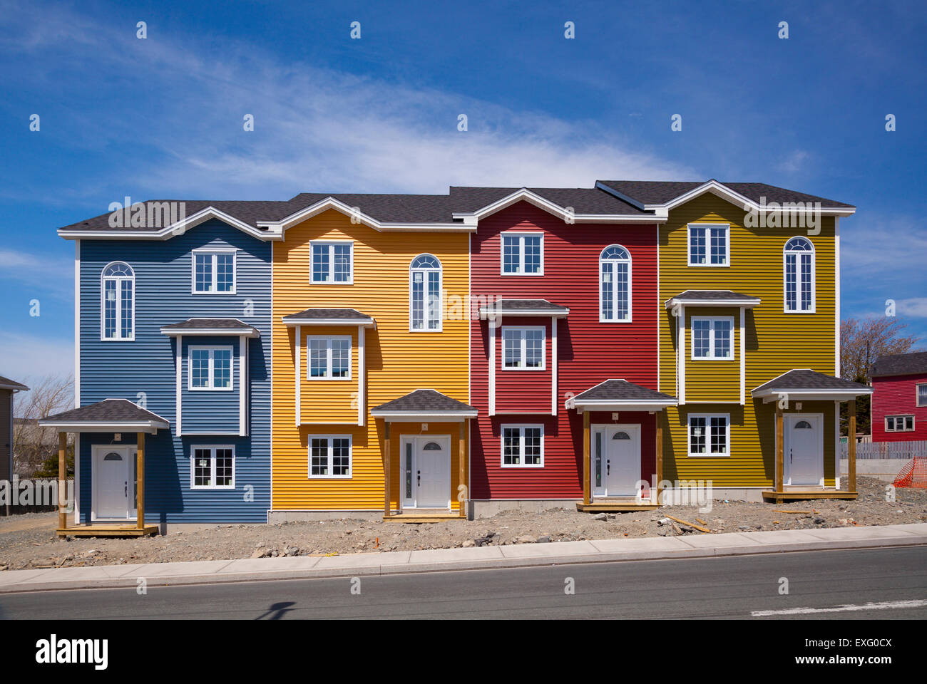 Four brand new colourful row houses on a sunny day in st for Newfoundland houses