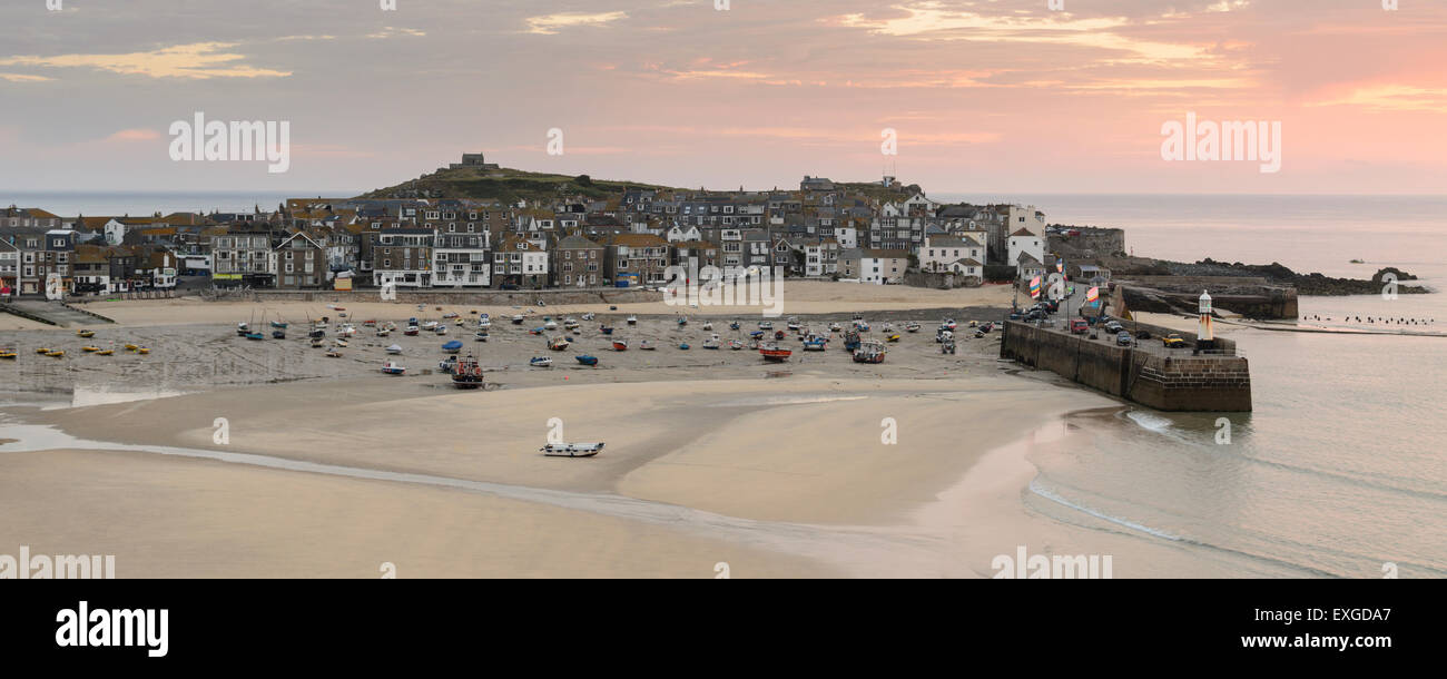 The view at sunrise of St Ives, Cornwall, England. A fishing town popular with artists and tourists on the North - Stock Image