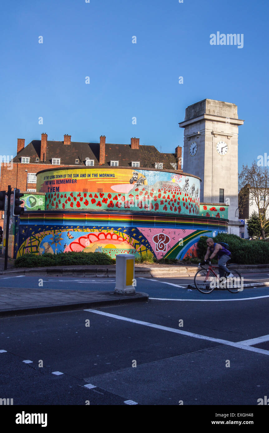 Stockwell war memorial by Frank Twydals Dear, 1922, and memorial mural, 1999-2001, Stockwell, London, England - Stock Image
