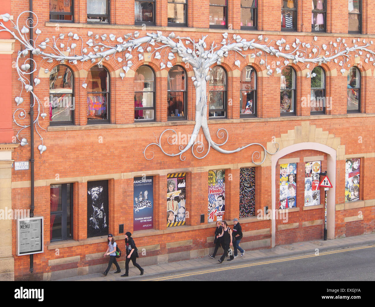 Tib Street elevation of Afflecks Palace indoor market with galvanised steel tree by David Hyde and mosaics by Mark - Stock Image