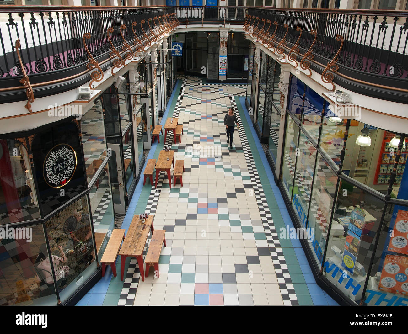 Interior of Barton Arcade a victorian shopping centre in Manchester UK looking to the shops and cafes on the ground - Stock Image