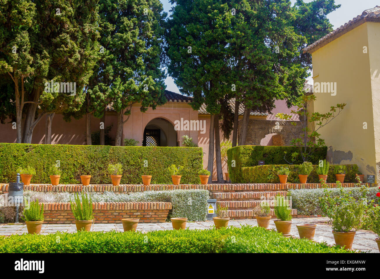 Courtyards and gardens of the famous Palace of the Alcazaba in ...