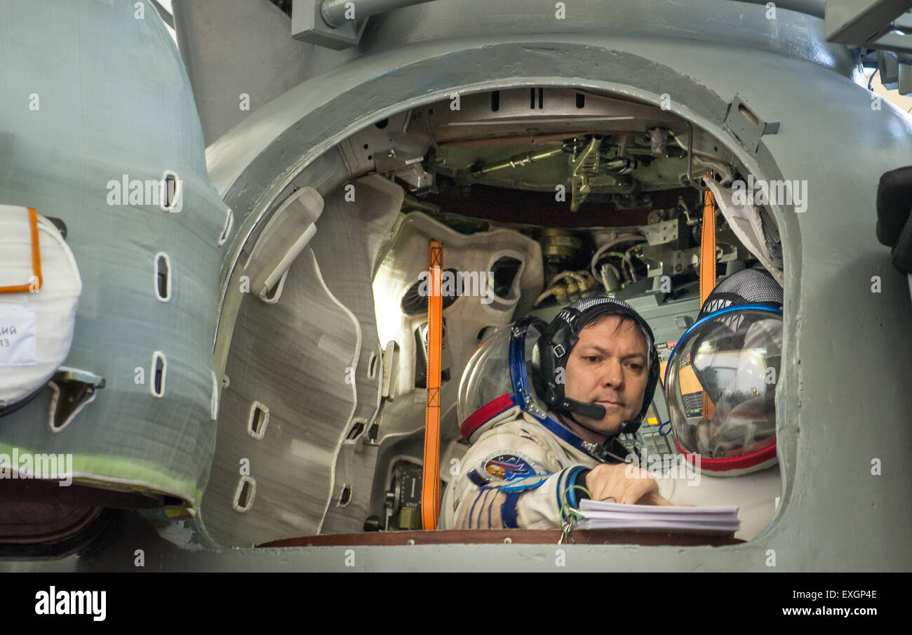 Russian cosmonaut Oleg Kononenko reviews his paperwork during the second day of qualification exams with Japan Aerospace - Stock Image